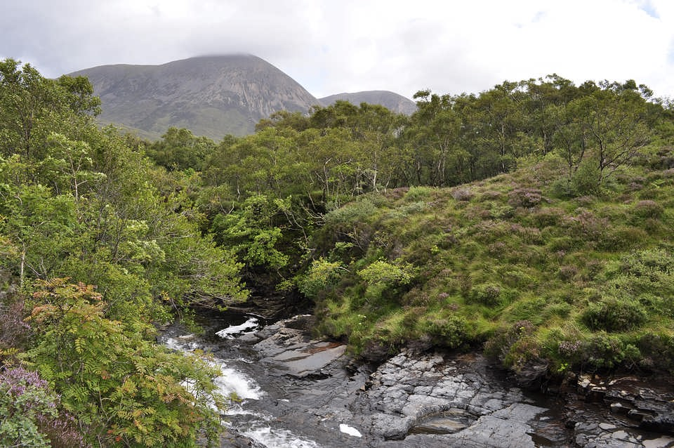 The Red Cuillins from the river flowing down from the slopes of Blaven.